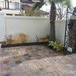 Well water rust stains located on stucco wall from sprinkler system